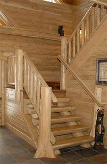 Log staircase hand made by Heartwood Mills (previously Town & Country Cedar Products)