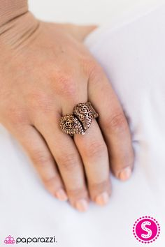 Dotted and stenciled filigree joins into a romantic heart frame. Brushed in an antiqued shimmer, the feminine display curls around the finger in a casual fashion.  Sold as one individual ring.