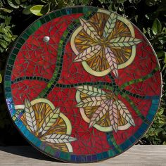 Mosaic Plate by jackienoyes, via Flickr ~ using transparent glass in a mosaic can add depth by creating shadows in the mosaic
