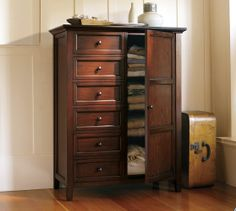 The chifforobe ... an old solution to a modern problem.  Look for vintage ones.