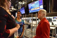All around The Weather Channel's offices, news and data about the weather appear on big screens. The Administrator chats with staff members while the latest reports about then-upcoming Hurricane Joaquin play in the background. (3 of 15)