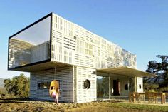 Casa Manifesto in Chile built from shipping containers and a shipping pallet rain screen
