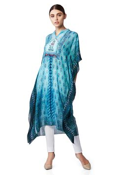 This pretty tunic has a light and breezy feel about it.  Presenting a blue digital printed kaftan in gentle pattern.INR 7,990.00