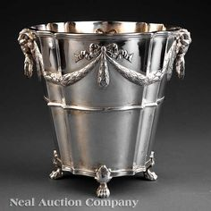 A Neoclassical-Style Silverplate Wine Cooler, with ram's head handles and chased laurel swags, paw feet,