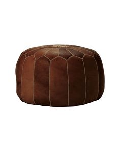 Perfect as a footstool or extra seating, our fabulous poufs are at home in any room of the house. Handmade by artisans in Morocco, each  is unique, with subtle variations in color. Individual pieces of leather are dyed to perfection, then stitched together and embroidered by hand. The poufs are then filled with dense cotton, which takes longer to assemble but results in a substantial, sturdy construction that lasts for years to come.