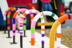 Yarn Bomb Bike Parking in front of Bus.