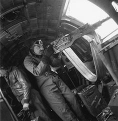Captain Clark Gable (1901 - 1960) in his war time capacity as captain of gunnery at an American Bomber station 'somewhere in Britain'. Gable's main role is to instruct new recruits, but has also made a training film that involved a bombing mission over Antwerp ~