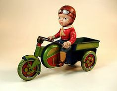 """beautiful tin and celluloid """"motorcycle delivery boy"""" 8 1/2 inches long...C.K. Japan, 1930's"""