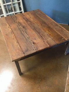 Steel leg reclaimed barn wood coffee table