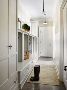 Molly Quinn Design: Fabulous galley style mudroom with wall of built-in cupboards and nooks with storage ...