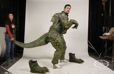 Trevor L. Hensley and Dawn Dininger test the movement of one of the Zorgon suits from ZATHURA.