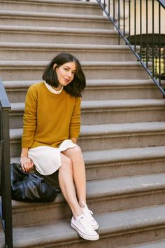 Three Fall Outfits | A Cup of Jo: mustard sweater layered over a dress + white chucks