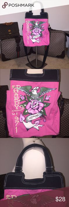 Authentic Ed Hardy pink cross body purse Authentic Ed Hardy pink cross body purse. Size 11x17x4, Long strap is 53 inches completely extended. The strap is adjustable Ed Hardy Bags Crossbody Bags