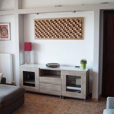 α 3D πάνελ τοίχου είναι μια πρωτοποριακή ιδέα στην διακόσμηση του σαλονιού. Συνδυάζουν την ιδιότητα ενός πίνακα ή ενός επίτοιχου γλυπτού με ιδιότητες ηχοαπορρόφησης. Κατασκευασμένα από κομμάτια ξύλου που έχουν κολληθεί σε μια ξύλινη βάση, τα ξύλινα πάνελ τοίχου δημιουργούν ένα απίθανο μωσαϊκό. Αυτά τα υπέροχα διακοσμητικά κατασκευάζονται με διάφορα είδη ξύλων. Στην συνέχεια βάφονται σε διάφορα χρώματα δημιουργώντας μια πανδαισία χρωμάτων που ταιριάζει με τα υπόλοιπα αντικείμενα του σαλονιού… Decor, Cabinet, Home Decor, Storage, Furniture