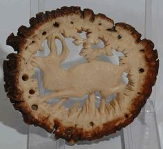 Vintage Loferl - rosette carved from stag antler. Appliqued to Lederhosenträger and such.