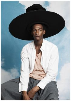 Ty Ogunkoya Wears Really Big Hat & Poses with Snake for Arresting Paraiso Shoot
