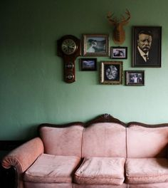 amazing colour clash, sofa and picture/objects grouped ... basically I love all of this!