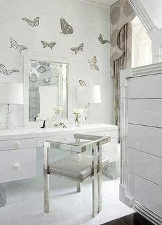 Butterfly wallpaper in white dressing room, love this gorgeous chair, stunning!