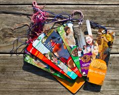 """My kiddos, looking for """"prizes"""" to give away to good customers at their cookie booths this year, created bookmarks out of old Girl Scout cookie boxes."""