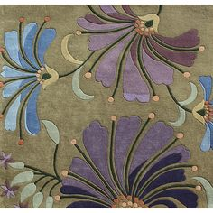 Update your home with this New Zealand wool rug in shades of green, blue and purple. This rug can really tie your room together.