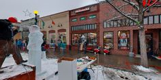 We had snow this winter for Winterfest and the Seahawks are doing great. GO HAWKS!  I captured this ice carver creating a Seahawk football player in front of Kelly's Ace Hardware in Chelan, Washington, USA during Winterfest 2015 (last weekend in Chelan and Alefest in Manson this weekend).