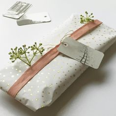 wrapping paper and gift tag Jurianne Matter for Ompak