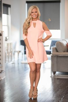This delightfully romantic look is perfect for a spring night out with your significant other! We love the gorgeous neon peach color - it's such a lovely and feminine shade! The material is so wonderf