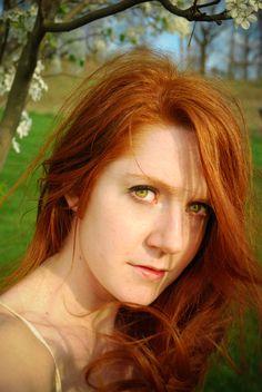 Mature redhead in green