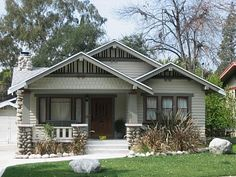 Arts and Crafts Bungalow characteristics include low-pitched roofs, overhanging eaves, and beautiful, handcrafted stonework...