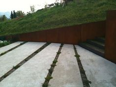 Corten steel walls and ecological paving from freiraumarchitektur's farmhouse project in Lucerne (Freiraumarchitektur)
