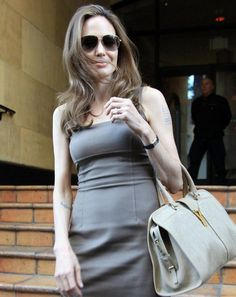 Style icon Angelina Jolie spotted carrying the hottest bag of the season YSL Cabas Chyc bag in taupe with a large gold Y clasp.