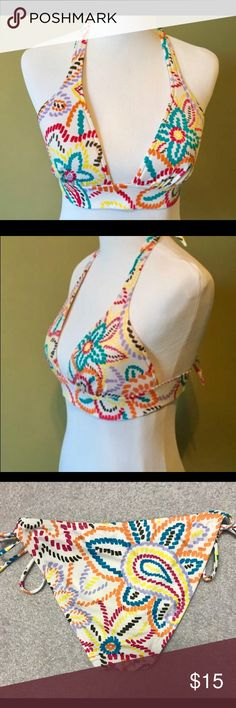 Victoria's Secret halter top/side tie bottoms NWOT Victoria's Secret brand women's halter style bikini top in size small. Features a thick band below the bust. White base color with graphic pixel style flowers in teal blue, orange, yellow, purple, and black. Ties in halter style at the neck and below the bust line in the back.  Includes matching side tie bottoms.  Great deal - $20.00 or best offer!  New without tags. Victoria's Secret Swim Bikinis