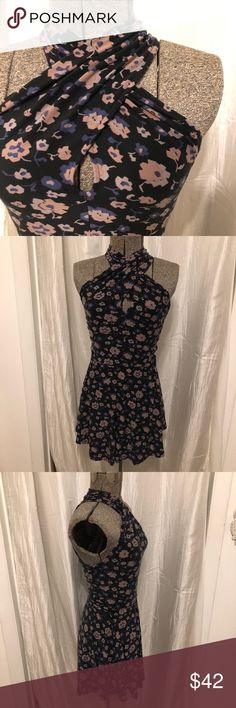 "Free People Top Free People flower print top. Colors include black, dark purple, & mauve. Originally bought as a dress but fit better as a shirt with leggings. Measures 22"" in length from armpit to bottom of top. Excellent condition. Size xs, but very stretchy to fit multiple sizes. Offers welcome! Free People Tops Tunics"