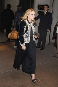 Pin for Later: 84 Styling Hacks We Learned From Mary-Kate and Ashley Olsen Velvet Embroidered Bombers Are the Type of Piece You Work Your Outfit Around Mary-Kate Olsen at the Four Seasons restaurant in New York City in 2009.