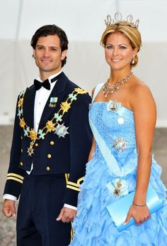 Prince Carl Philip and Princess Madeleine of Sweden at the wedding of their older sister, Crown Princess Victoria.  He looks like Orlando Bloom, she looks like Barbie.  Damn Swedes.