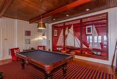Cottage Game Room with Crown molding, Pendant Light, Hardwood floors, Wall sconce, Exposed beam