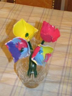Rainy day craft for my kids -- egg carton lilies.  Cut a single cup from the carton, poke a hole in the bottom, stick half a pipe cleaner through, glue with a glue gun, and let the kids paint it when the glue is cooled.