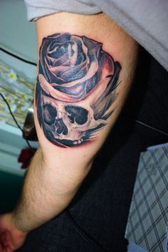 """""""I got this skull/rose (or 'Skose' as I sometimes call it :)) as a representation of life and death. I wanted something old-school but with a realistic touch. I chose the skull because I think skulls are pretty bad ass and the rose to make it a little more subtle.    I designed it myself and got it done at Veni Vidi Vici Tattoos in the Netherland by Emma Din, who is a great artist. I think she did it in about 5 hours."""""""