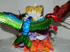 bEAUTIFUL AND AMAZING HAND CARVED HUMMING BIRD CANDLE! BE THE ENVY OF YOUR FRIENDS WHEN YOU SET OUT THIS CENTER PIECE;) THE COST IS $200  INCLUDING THE COST OF SHIPPING TO BUY THIS ONE AND ONLY TREASURE CALL perfect springtime centerpiece. to enquire on this candle please send an email to www.mcfcandles.com