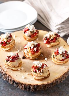 Greek Hummus Mini Tostada Stacks | cakenknife.com [corn tortillas, hummus, chopped roasted red pepper, marinated artichokes, black olives, minced fresh dill, feta]