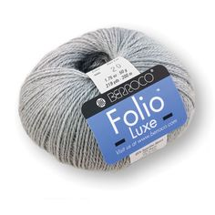 """Folio Luxe is the same Folio you know and love infused with glittering metallic strands, perfect for glamorous accessories. Ball Weight: 50g / 1.75 oz Ball Length: 219yds / 200m Knitting Gauge: 5.5 sts = 1"""" 22 sts & 32 rows = 4"""" (10cm) Needle Size: 5 (US) / 3.75 mm Crochet Gauge: 5 sc = 1"""" 20 sc & 26 rows = 4"""" (10cm)"""