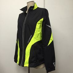 Brooks Night Life windbreaker bright & reflective Like new. Probably worn 3 times. Dad insisted on the bright jacket when biking. With 2 side hip pockets and one breast pocket all zip. Inside breast pocket for iPod. Won't fit an iPhone 6, possibly a 5 though. Collar is lined with a thin fine fleece, helps keep the wind out. Draw strings at waist Brooks Jackets & Coats Utility Jackets