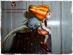 Elf on little wooden house €60
