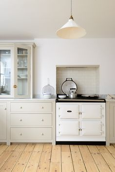 glazed countertop cupboards and simple pan drawers by deVOL