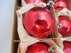 Boxes of Vintage Christmas Ornaments 2, Fantasia Brand Red Ball Tree Ornaments. Boxes of 1 Dozen each box, Christmas Ornaments, All Red ball ornaments in Original Boxes. Mostly used, have been in storage.  I have 8 boxes of these.  I found these vintage ornaments at an estate sale. Beautiful Red traditional color for ball ornaments. They are in their original boxes with their hanger caps. Did you see they originally sold for 59 cents?  There is usage or storage spots on some of them. I tried…