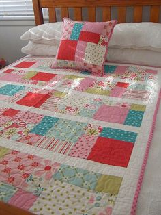 This is a sweet little quilt I made for my daughter Megan. She loves it!