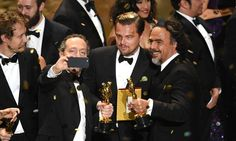Cinematographer Emmanuel Lubezki, actor Leonardo DiCaprio and director Alejandro Gonzalez Inarritu, all winners for The Revenant take a selfie onstage