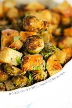 Roasted potatoes and brussels sprouts are easy to make & the perfect side dish idea. These contain rosemary & garlic powder but you can use any seasoning!