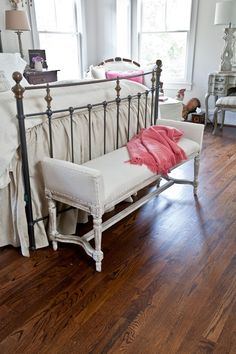 Add a French twist to your home decor with a small bench for the bedroom