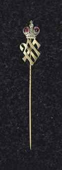 A GEM-SET GOLD STICKPIN BY FABERGÉ, WORKMASTER AUGUST HOLLMING, ST. PETERSBURG, 1899-1908. The terminal formed as the cypher of Grand Duke George Mikhailovich, surmounted by a diamond and ruby set Imperial crown.